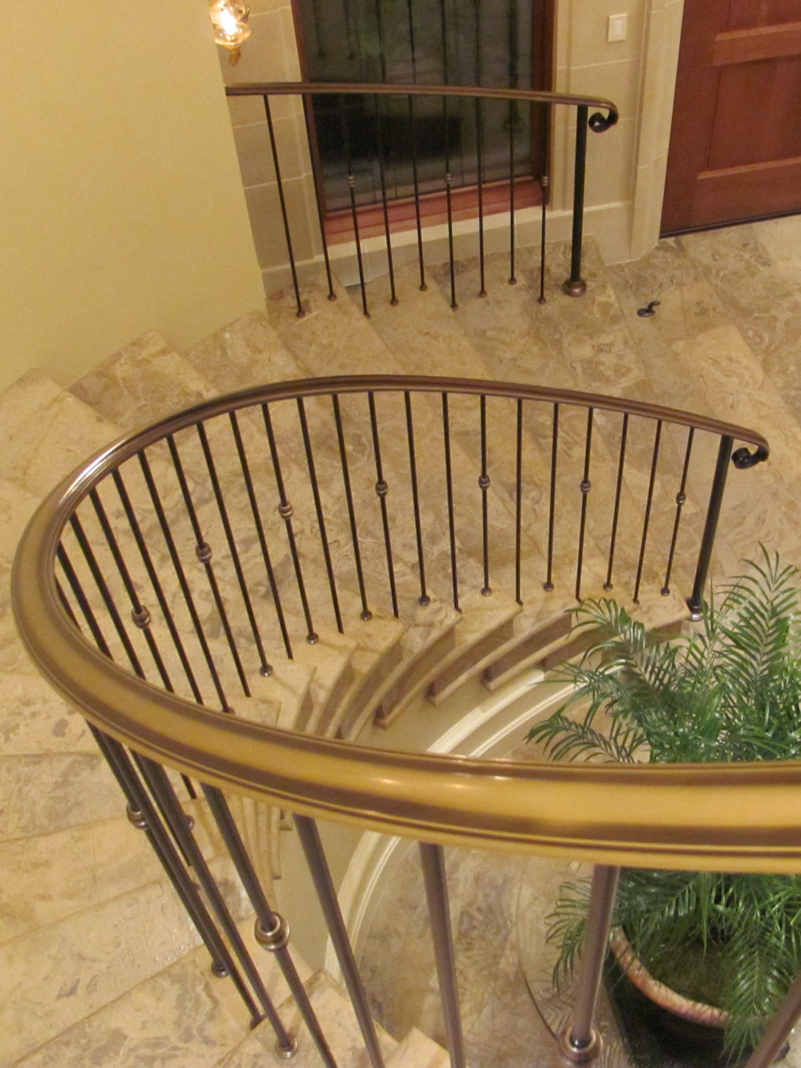 Elegant Pitch and Curved Railing - Featured Image