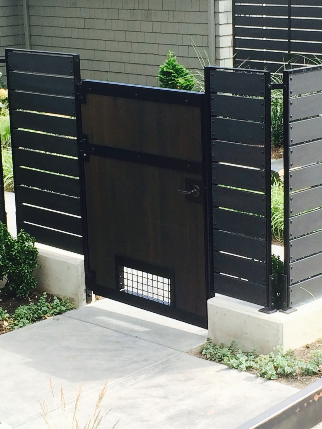 Modern Backyard Fence & Gate by Blackbird Iron